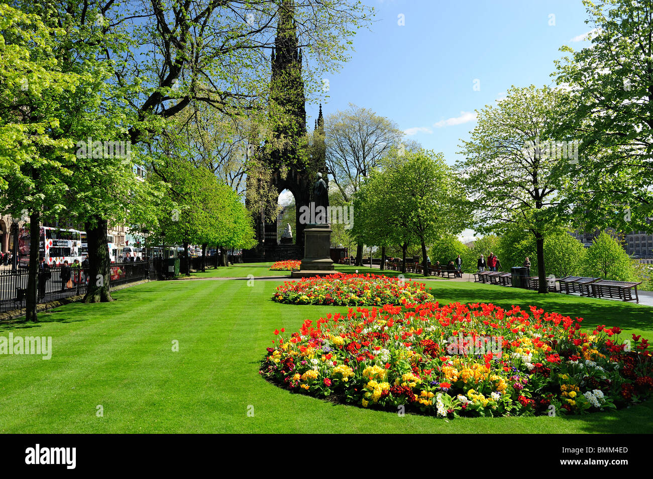 Spring flowers in Princes Street Gardens with Scott Monument in background, Edinburgh, Scotland - Stock Image