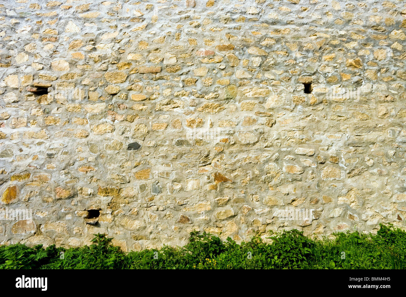 Stone masonry wall of the house. - Stock Image