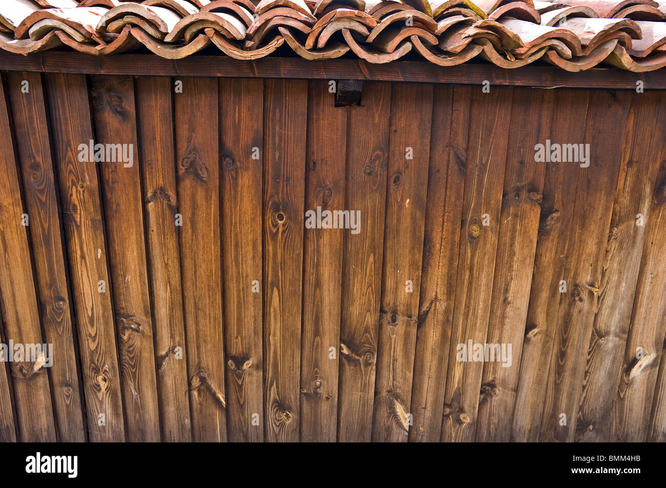 Wooden wall covered with tiles. - Stock Image