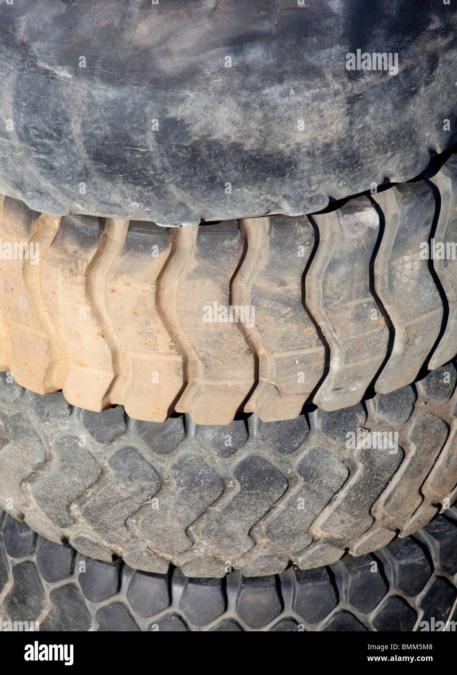 Pile of used front loader tyres - Stock Image