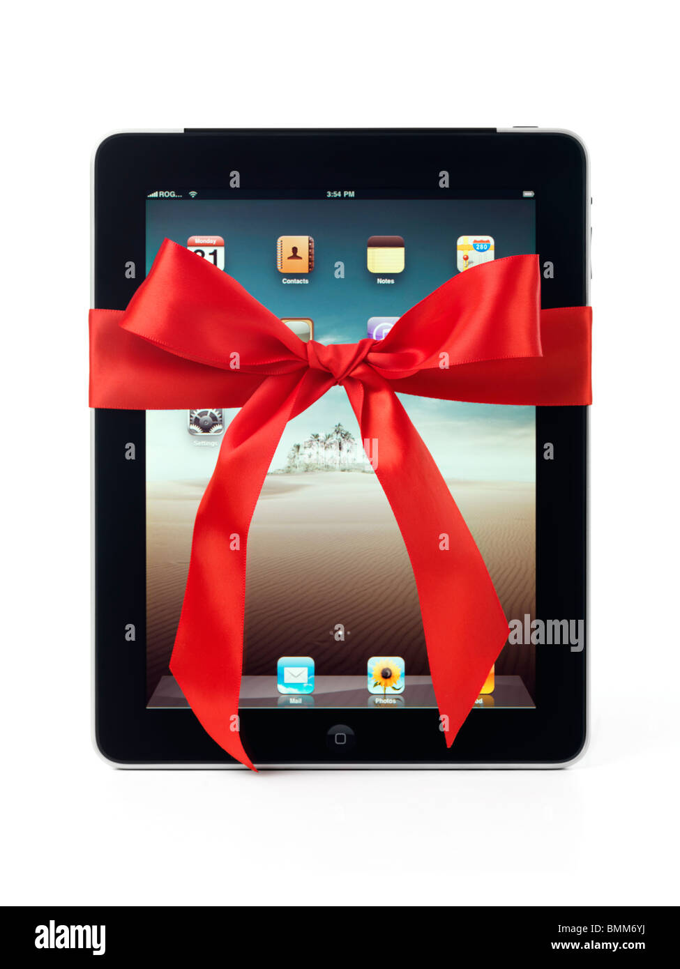 Apple iPad 3G tablet with a red gift bow tied around it isolated on white background Stock Photo