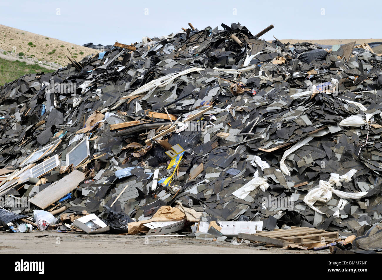 Mound of construction debris at landfill in Bourne Massachusetts - Stock Image