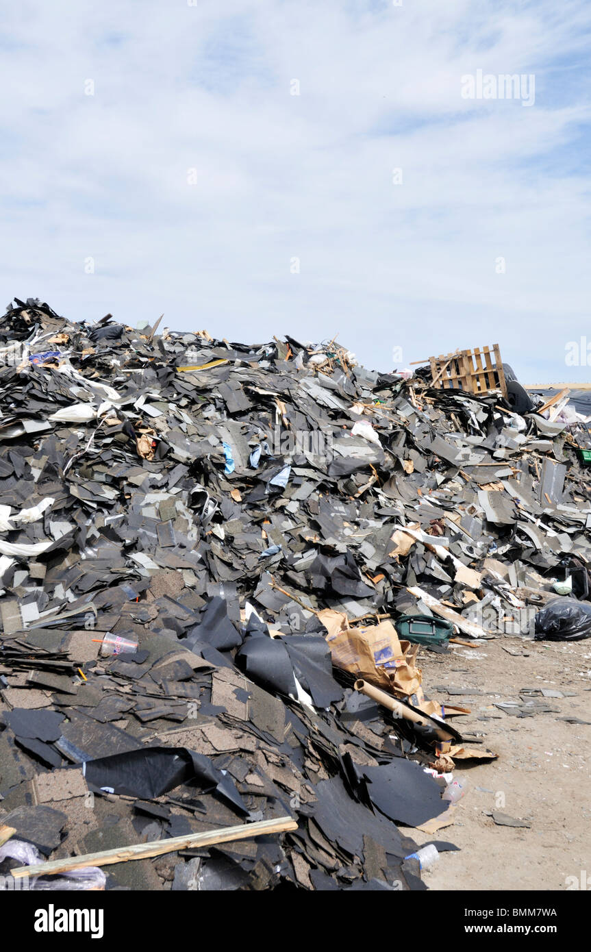 Big pile of commercial construction debris at landfill. - Stock Image