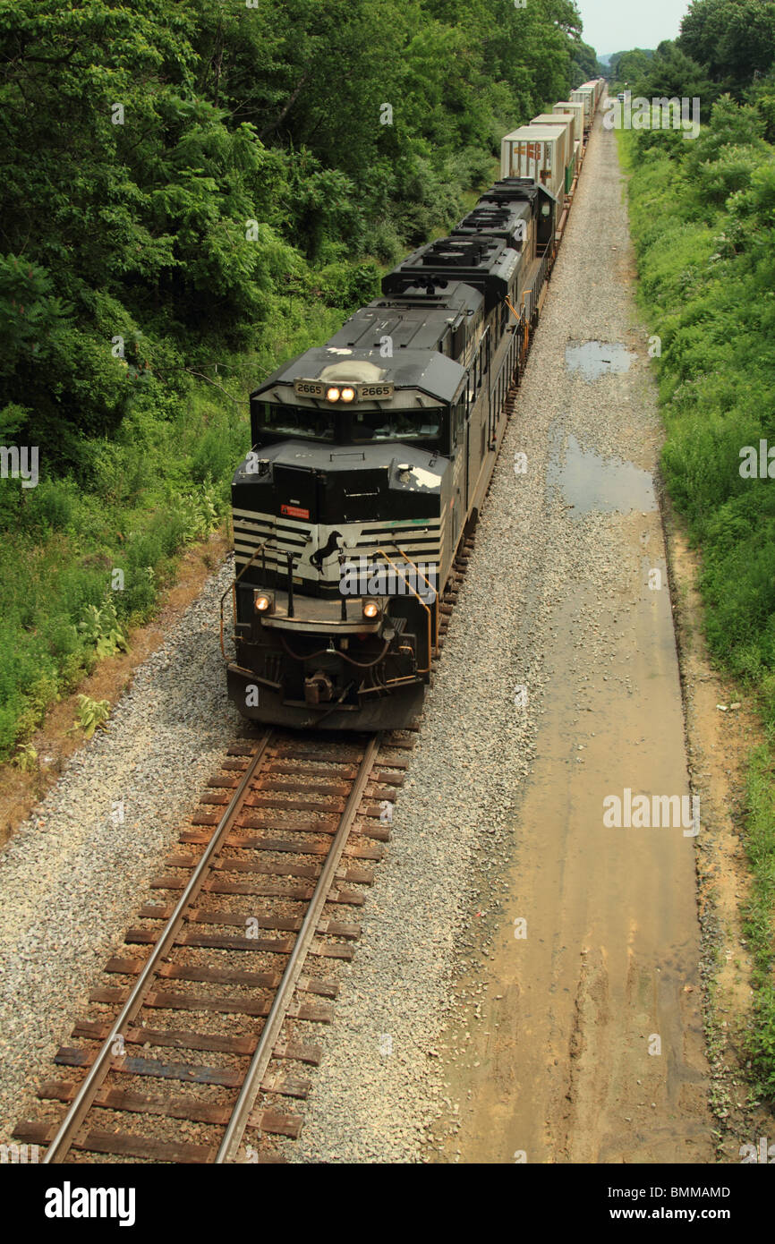 Westbound freight train of containers being hauled by General Motors power. - Stock Image