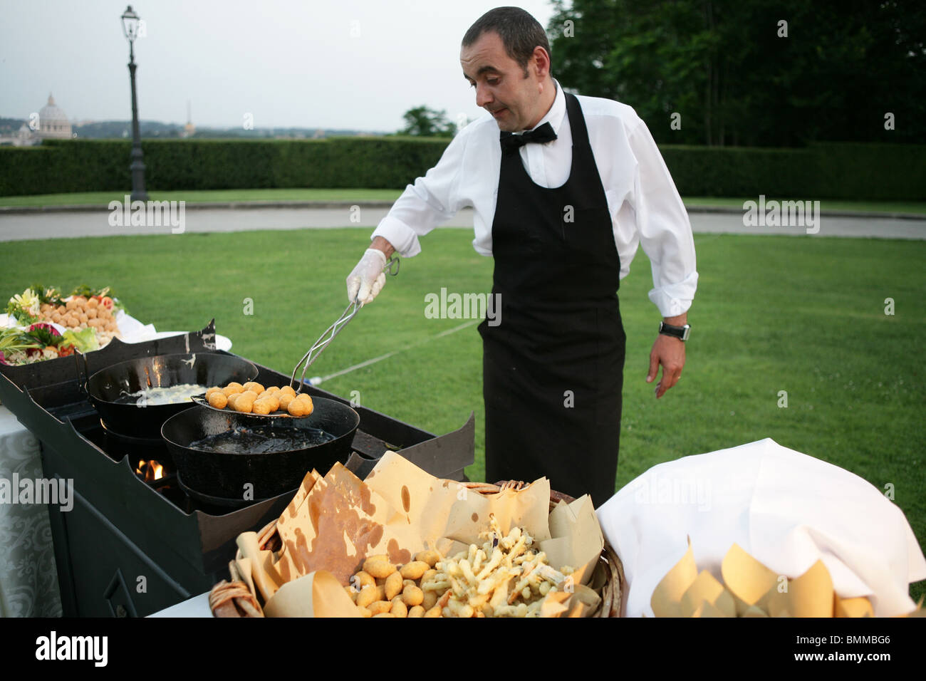 Chef Garden: A Man Chef Cook Cooking Some Fried In A Outdoor Villa