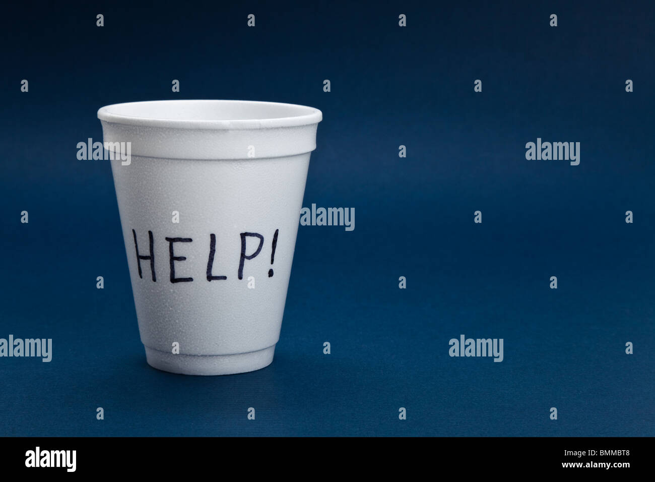 Disposable Cup, help, concept of Begging - Stock Image