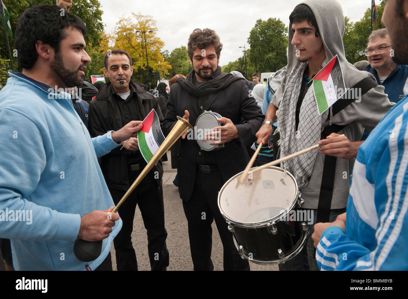 Young Muslim men with drums and instruments at Al Quds Day (Jerusalem Day) march in London - Stock Image