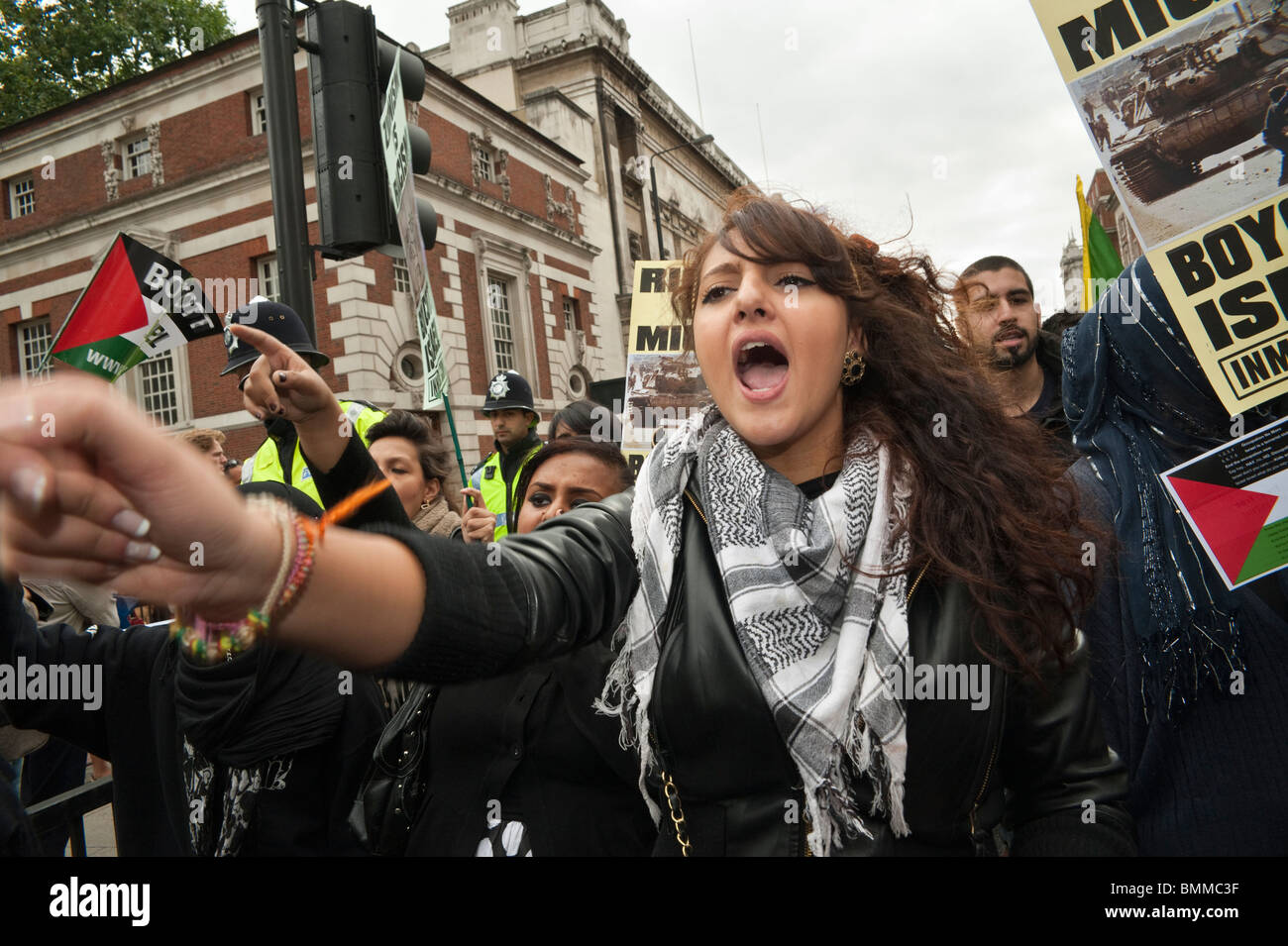 Young woman in Palestinian scarf in Al Quds Day (Jerusalem Day) march in London - Stock Image