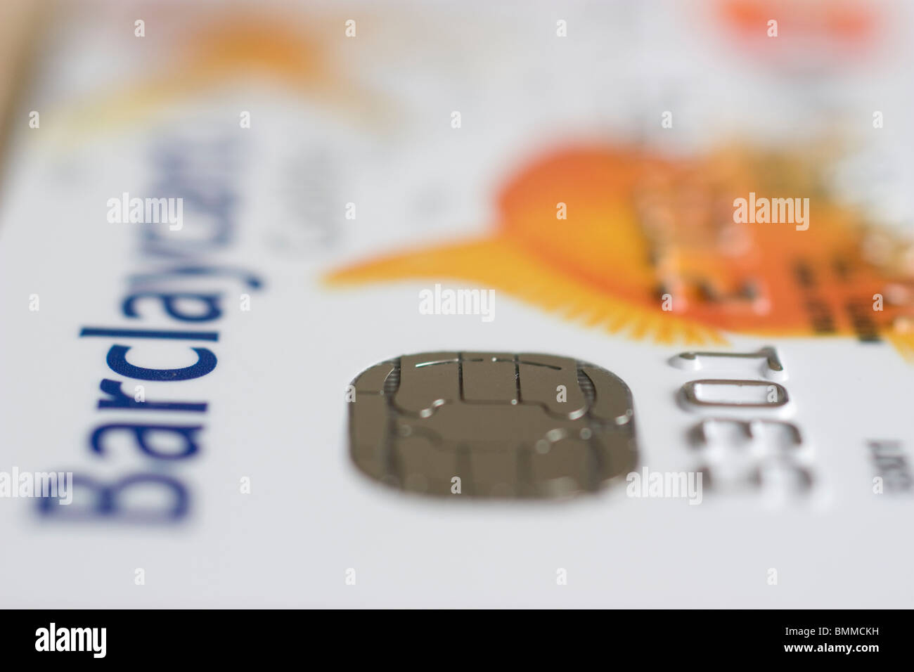 A smart card, chip card, or integrated circuit card ICC on goldfish barclaycard - Stock Image