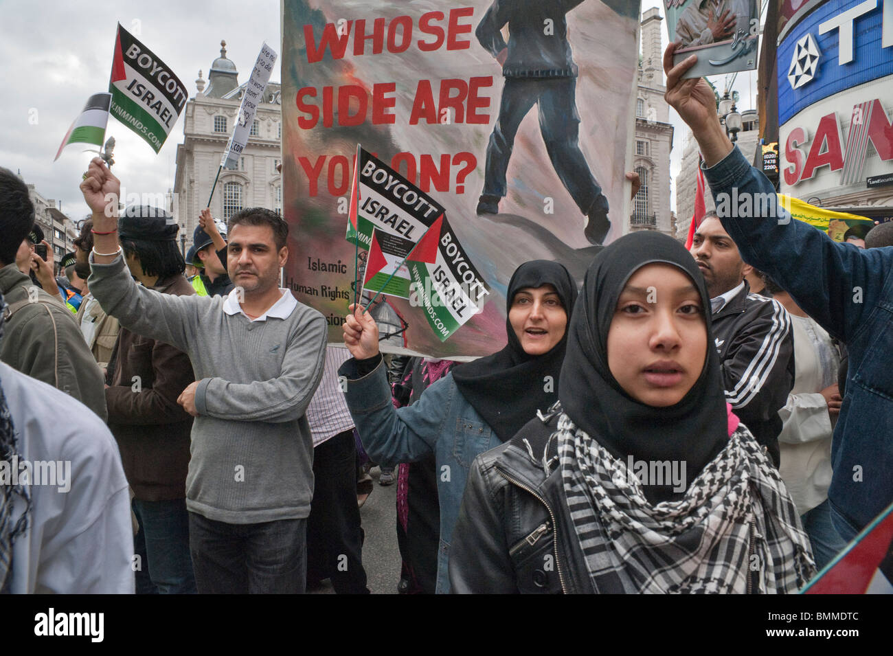 Marchers with Palestinian flags call for boycott of Israel on Al Quds Day (Jerusalem Day) march in London - Stock Image