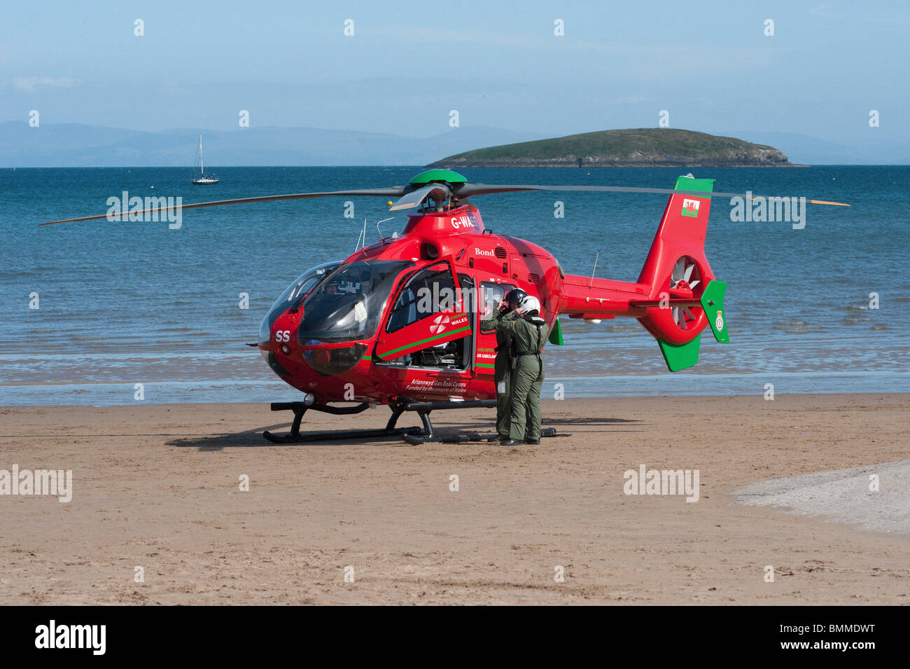 Welsh Air Ambulance on Beach, Crew standing - Stock Image