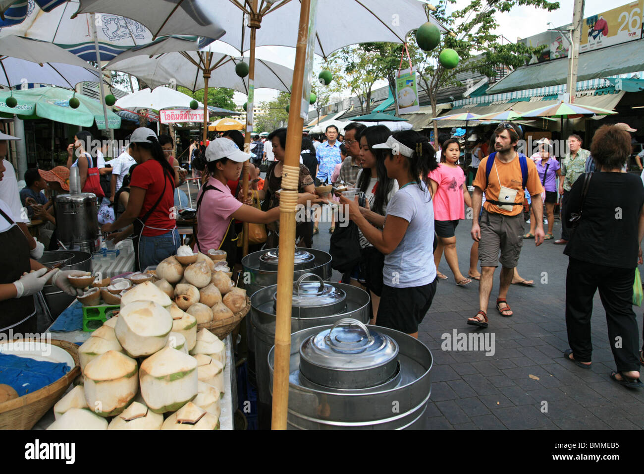 coconut ice cream stall at Chatuchak weekend market, Bangkok - Stock Image
