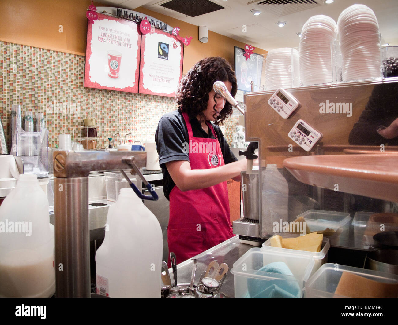 Starbucks Coffee Shop Barista At Worklondonuk Stock Photo