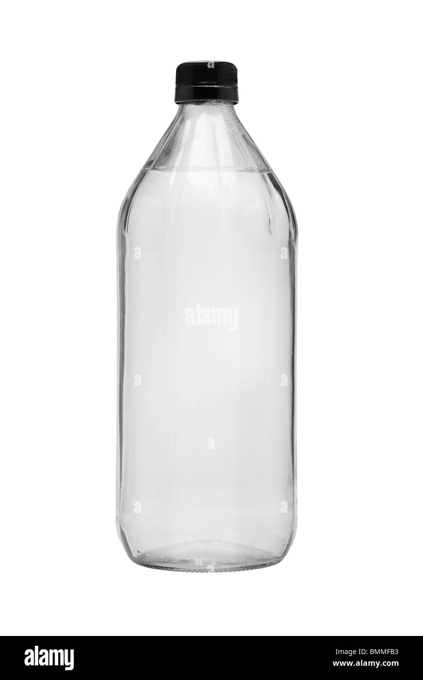 Drinking water in glass bottle on white background - Stock Image