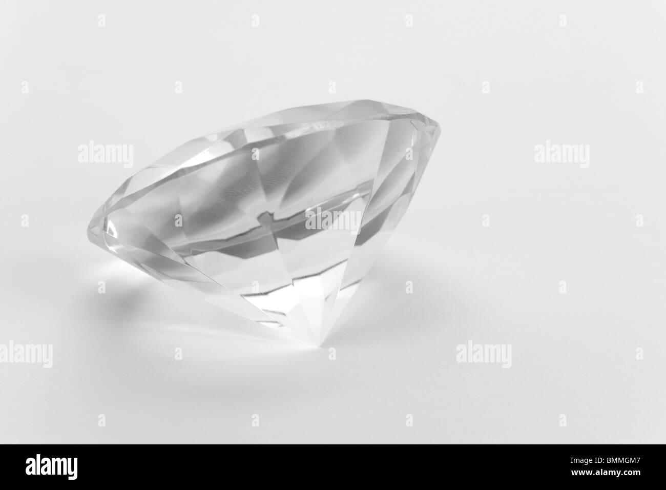Diamond close up shot with white background - Stock Image