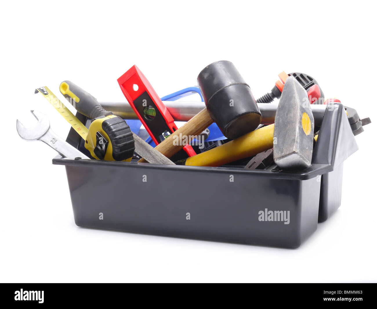 Plastic black toolbox with tools over white background - Stock Image