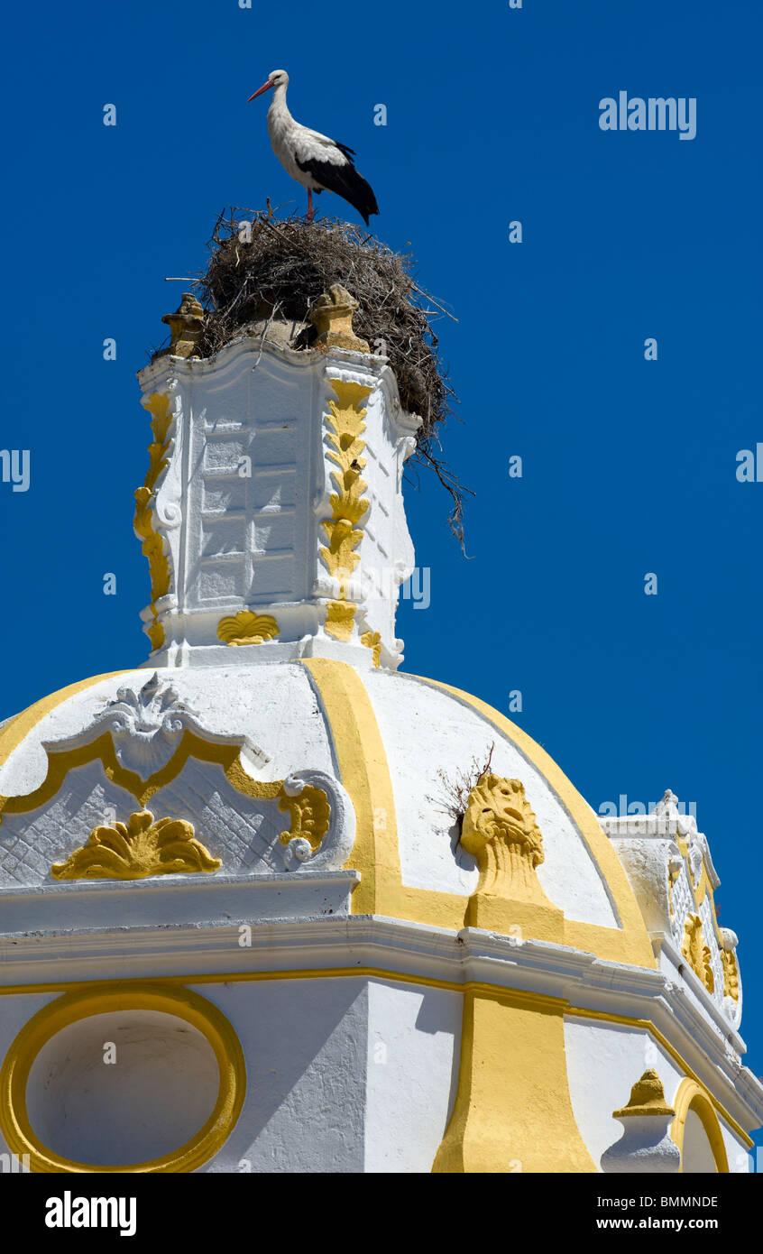 Portugal, the Algarve, Faro, the Capela de Santo Amaro church dome with a stork's nest on top - Stock Image