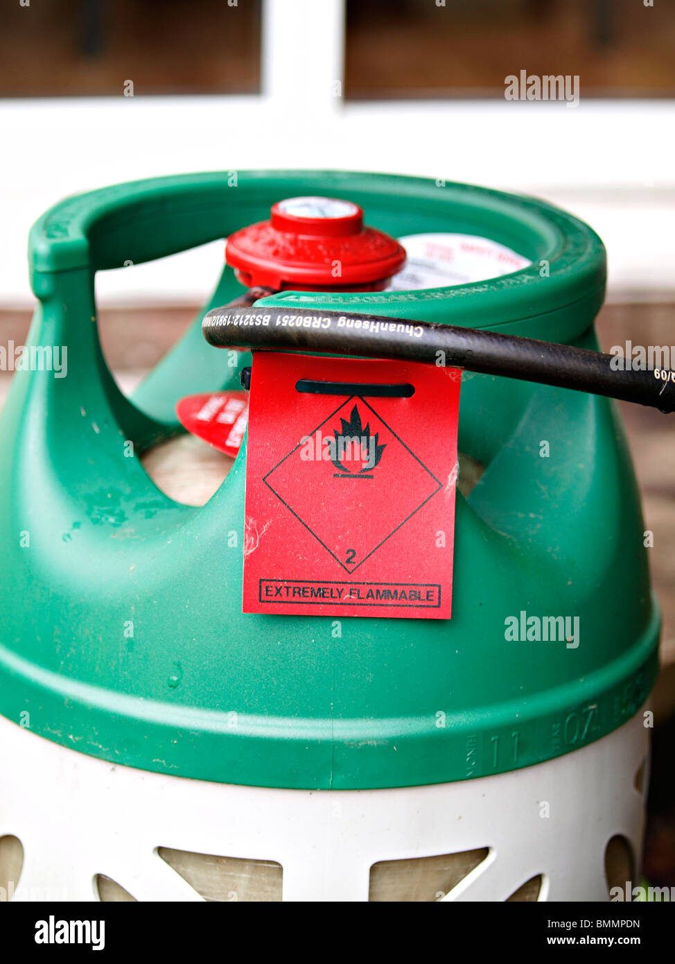 Barbeque gas is extremely flammable and should be handled with care - Stock Image