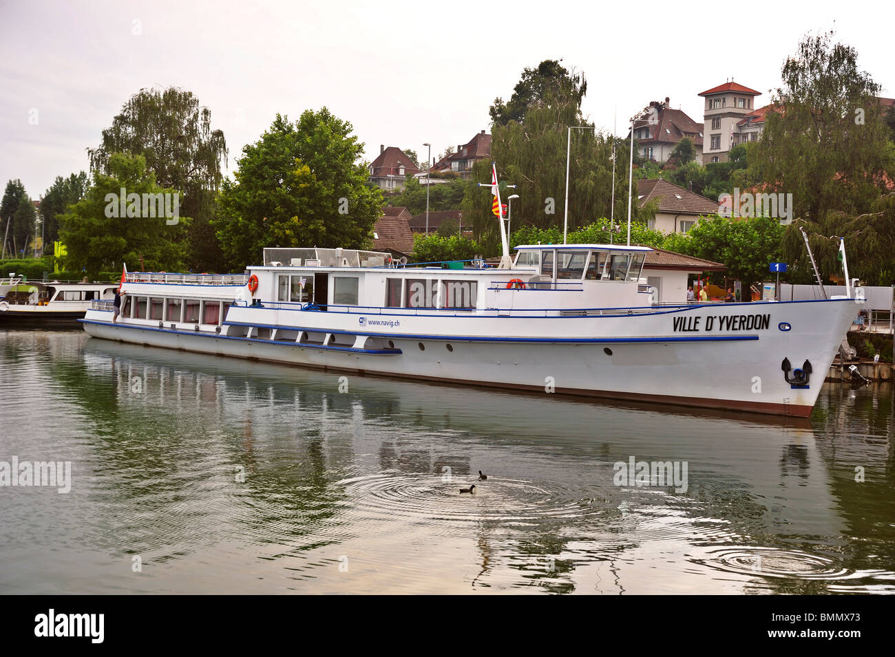The Ville d'Yverdon, a Swiss tour boat that plies the lakes of Morat, Murten and Neuchatel , moored in the harbour - Stock Image