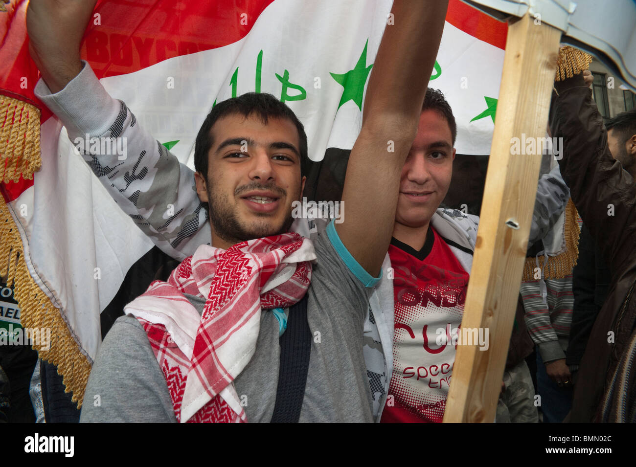 Young Muslim men and flag in Al Quds Day (Jerusalem Day) march in London - Stock Image