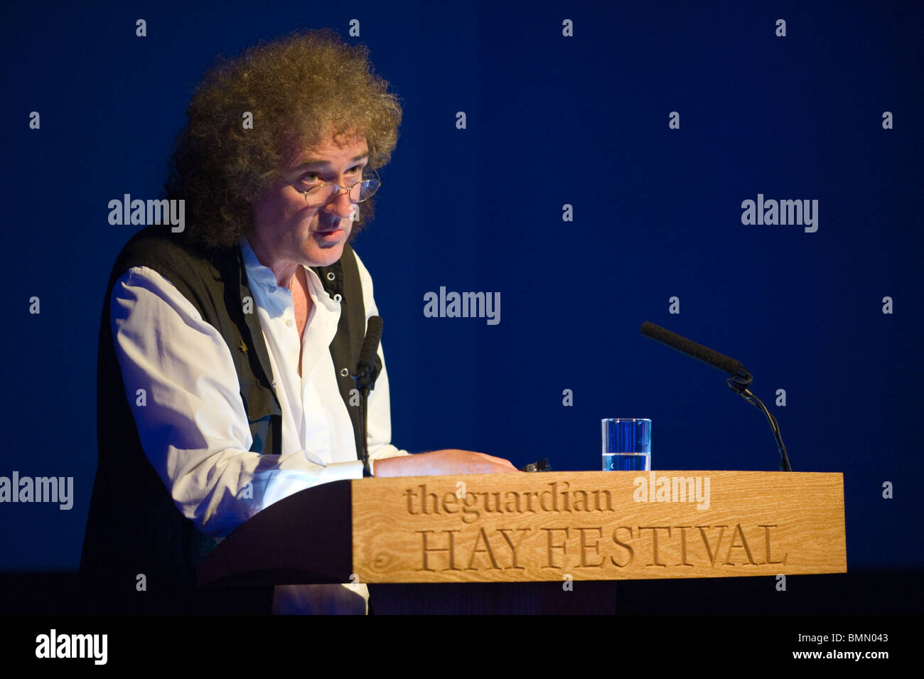 Brian May Queen guitarist & badger campaigner pictured speaking at lectern during Hay Festival 2010 Hay on Wye Powys Stock Photo