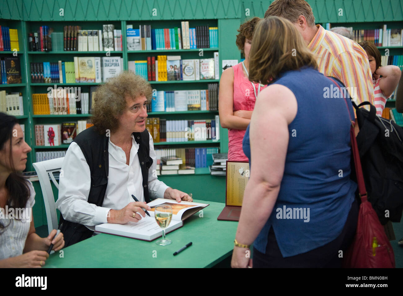 book signing Queen guitarist Brian May pictured book signing in bookshop during Hay Festival 2010 Hay on Wye Powys Stock Photo