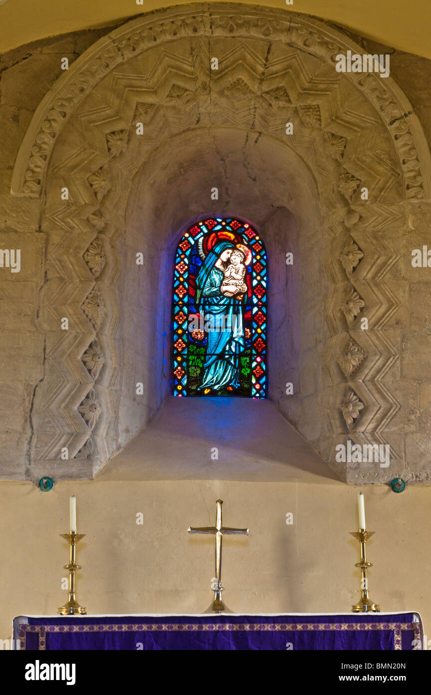 Stained glass of St John the Evangelist Church, Elkstone, Gloucestershire, Cotswolds, UK - Stock Image