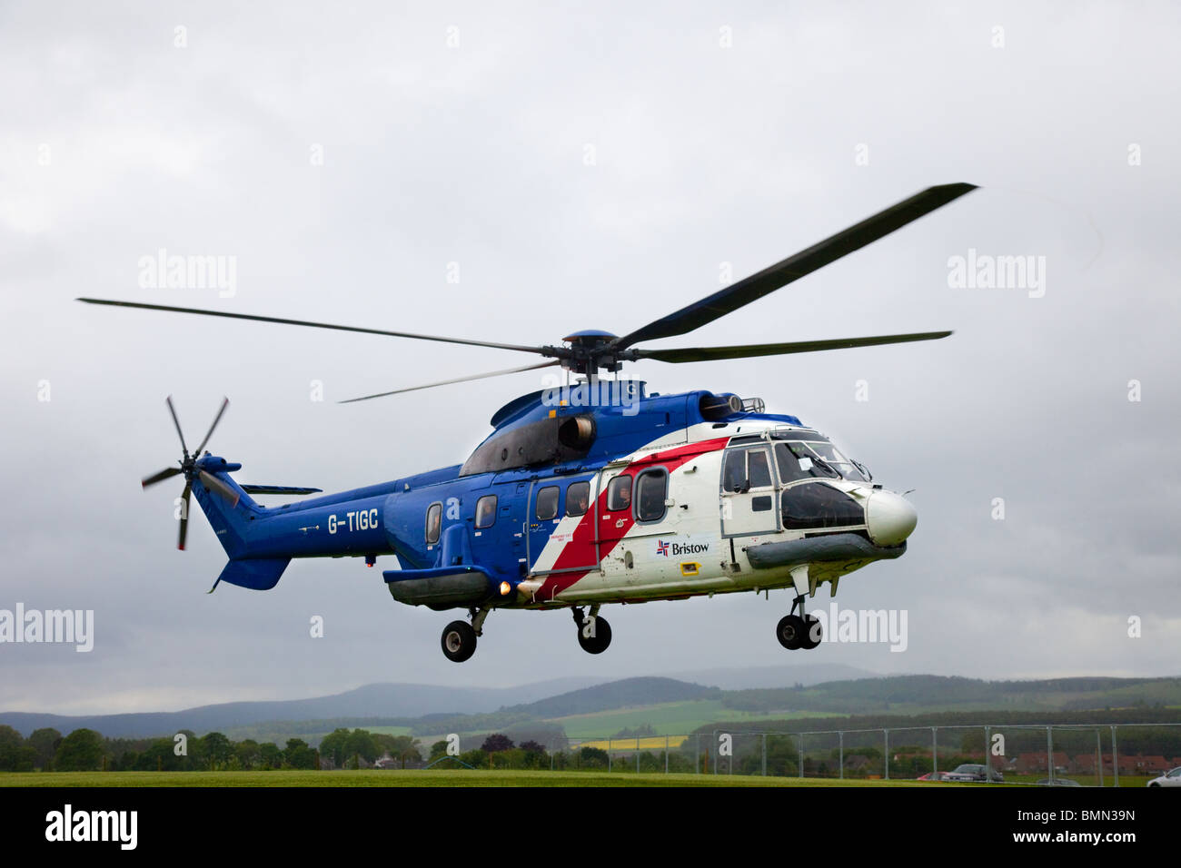 Flying Bristow Helicopter_ Eurocopter EC225 Aircraft, Aberdeenshire, Scotland, UK - Stock Image