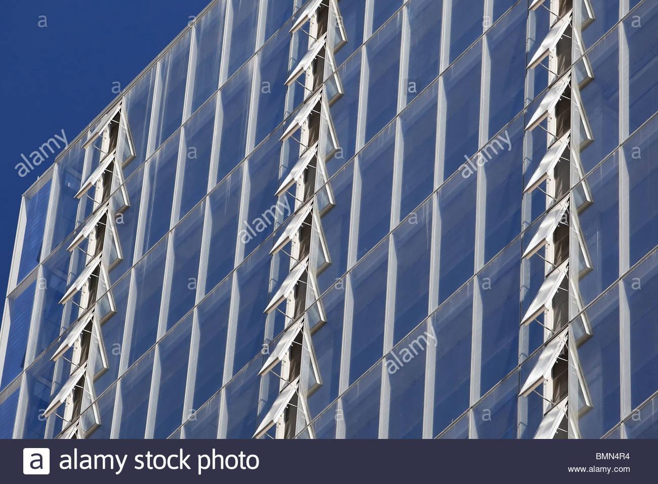 Rows of open windows on Manitoba Hydro Building, Winnipeg, Manitoba, Canada - Stock Image