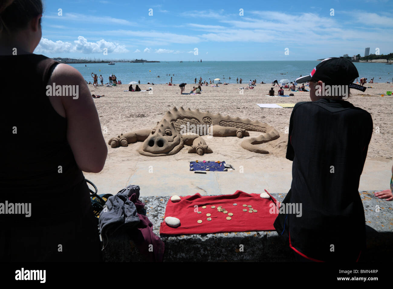 Sand sculpture of a Crocodile on the  Plage de la Concurrence - Stock Image