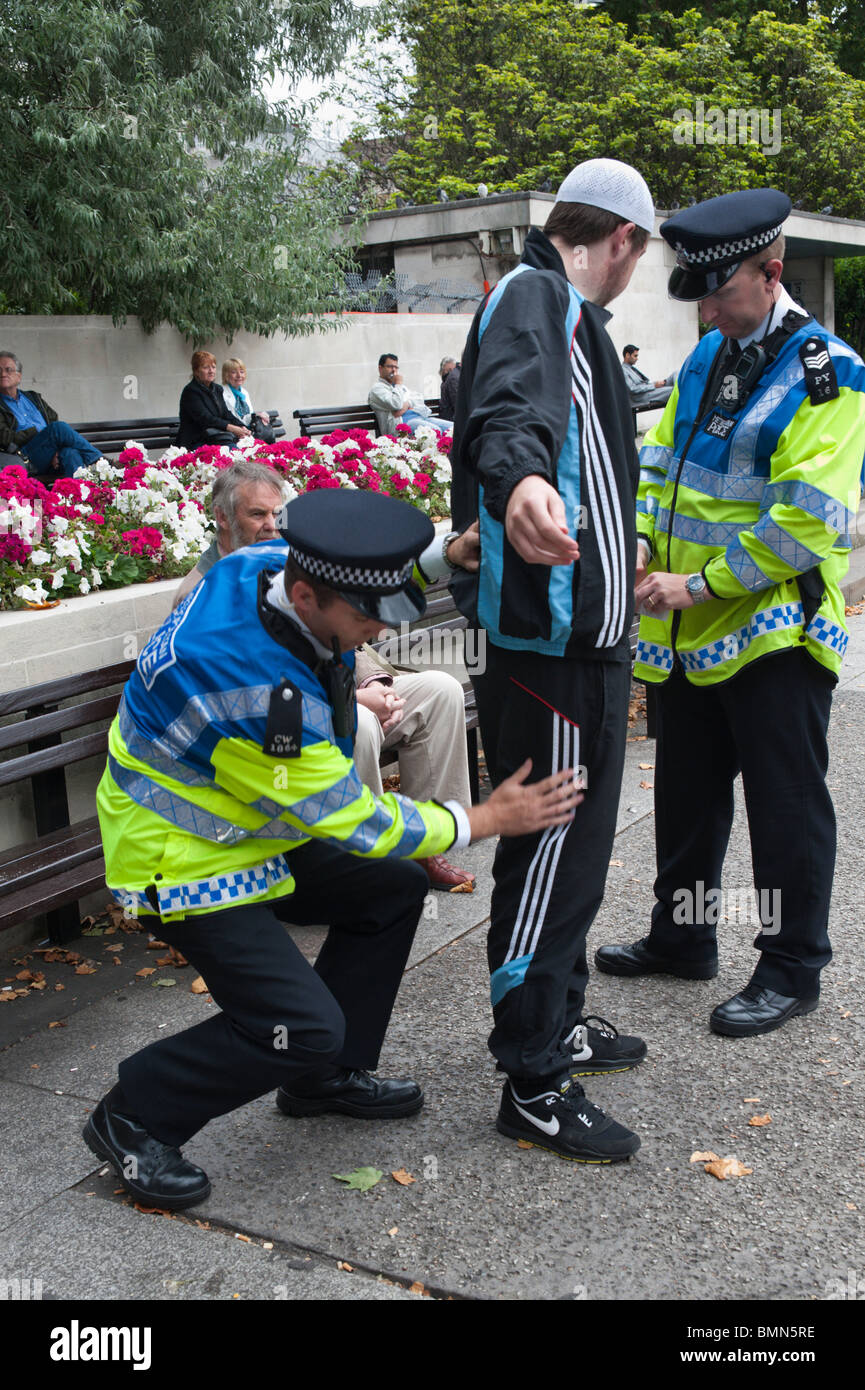Police stop and search young Muslim man before Al Quds Day (Jerusalem Day) march in London - Stock Image