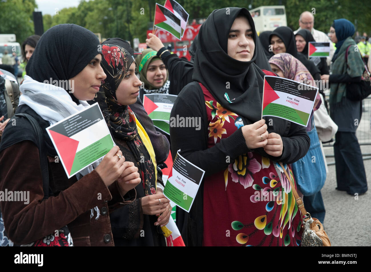 Young Muslim women with Palestinian flags at start of Al Quds Day (Jerusalem Day) march in London - Stock Image