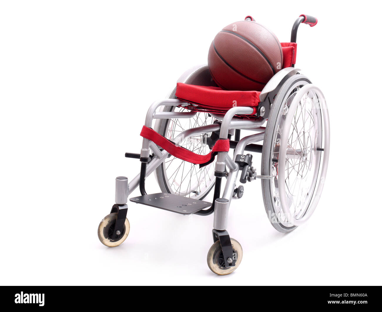 Active wheelchair with basketball isolated on white background - Stock Image