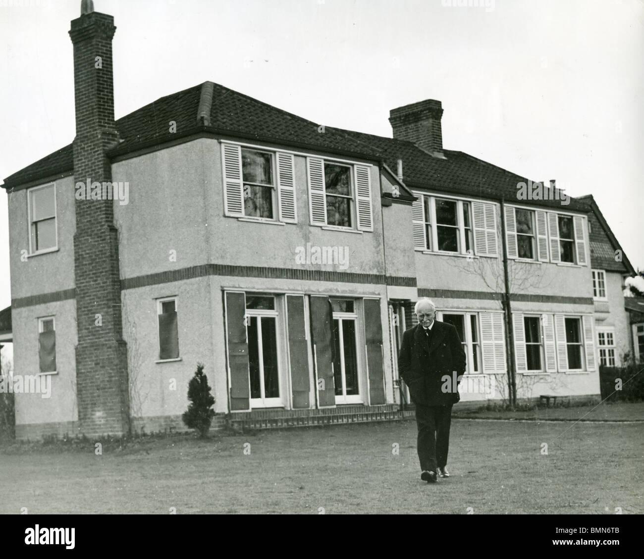 JOHN MASEFIELD  - (1878-1967) English poet at his home Burcote Brook near Abingdon in 1940Stock Photo