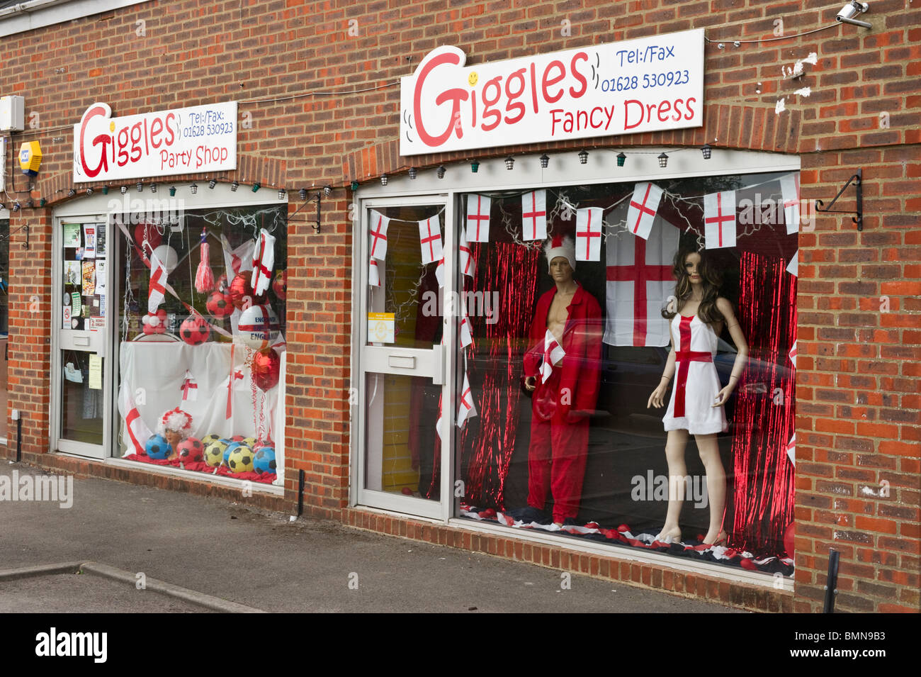 A fancy dress shop window display with English flags and World Cup football  memorabilia souvenirs 2010 cfdd1258fb8d