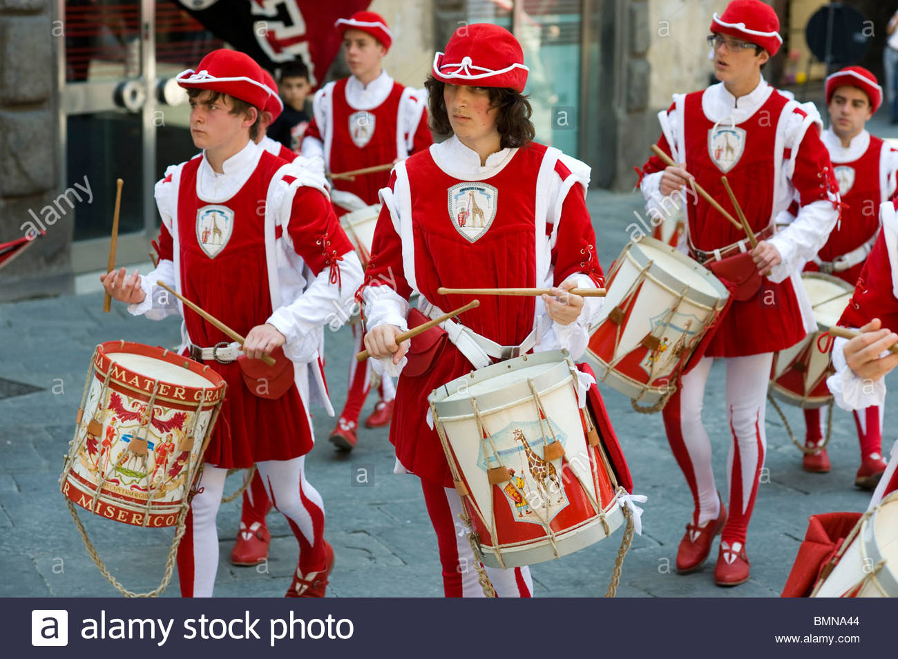 Residents of the Giraffa (Giraffe) contrada (district) of Siena rehearse for the annual Palio horse race, Siena, Stock Photo