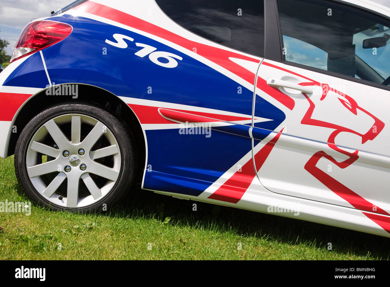 Detail shot of coach work on a Peugeot 207 S16. - Stock Image