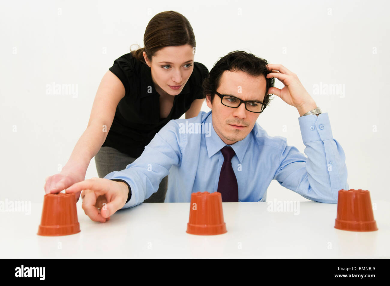 Couple ponder location of hidden item - Stock Image