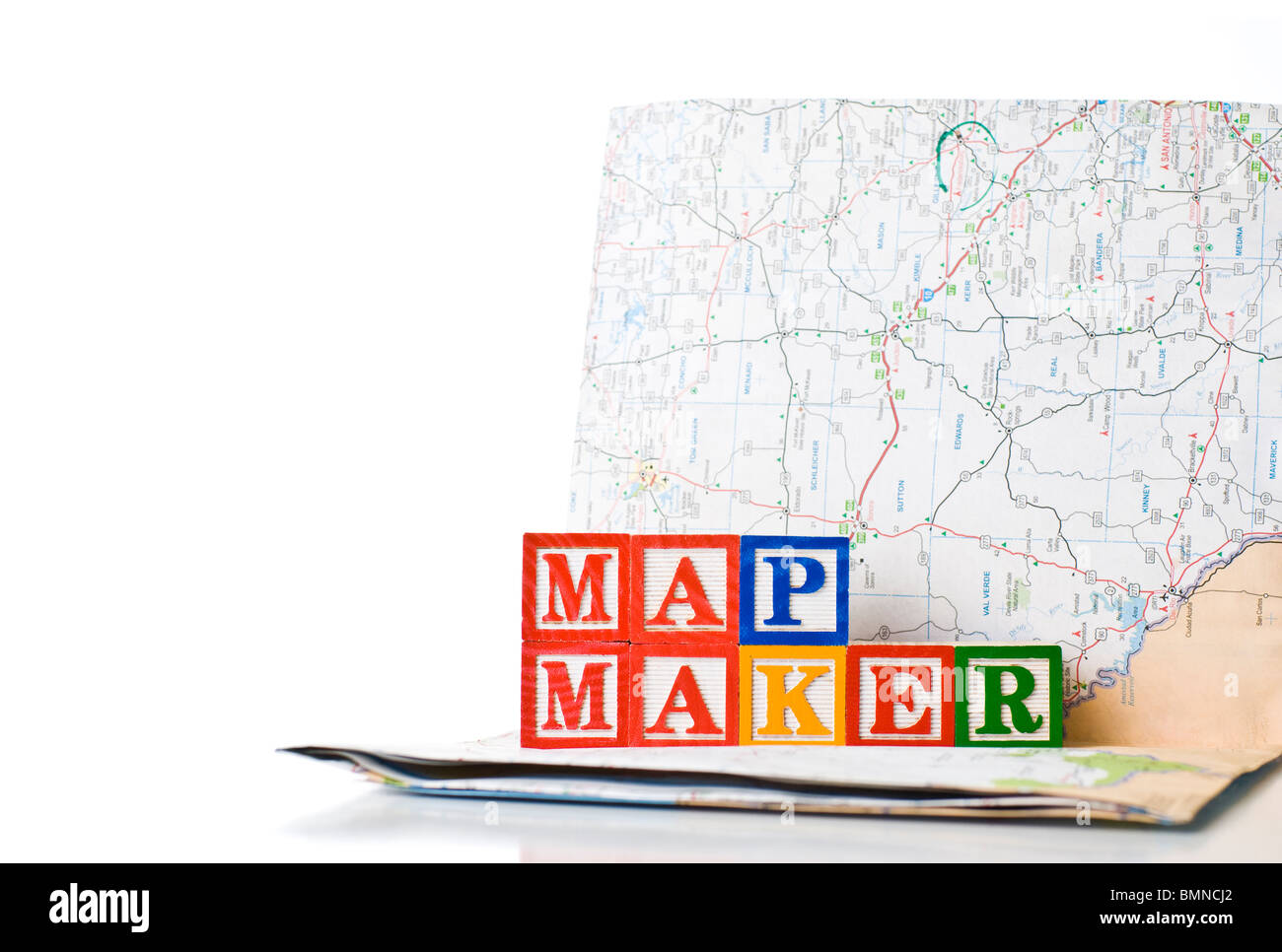 Colorful children's blocks spelling MAP MAKER with a map - Stock Image