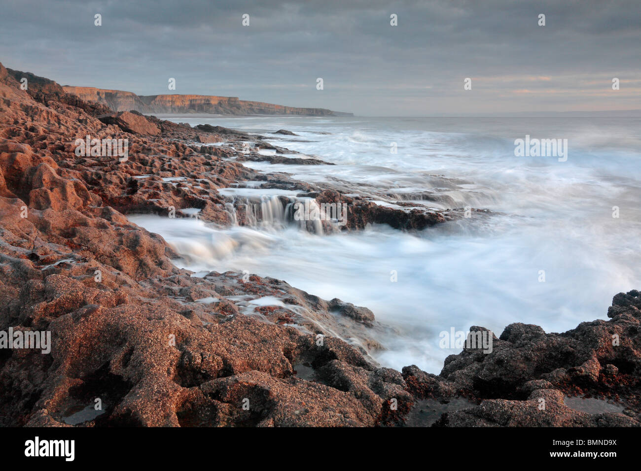 Autumn waves crash against the shores of the Glamorgan Coast in southern Wales - Stock Image