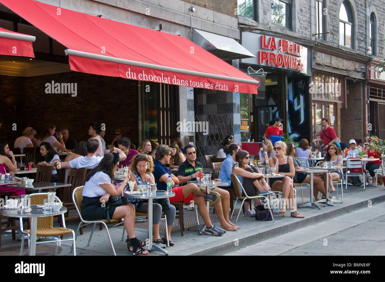 Sidewalk café on Saint Laurent boulevard Montreal Canada - Stock Image