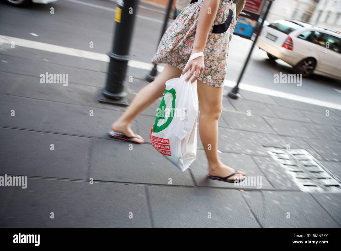 Young woman tourist in summer dress, walk with discount plastic shopping bag in the street of Rome Italy Europe Stock Photo