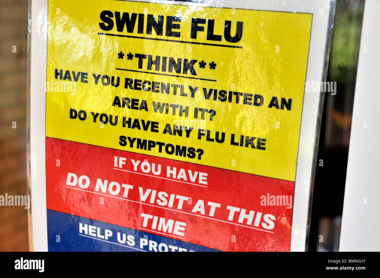 Swine flu warning sign placed on a building entry door. - Stock Image
