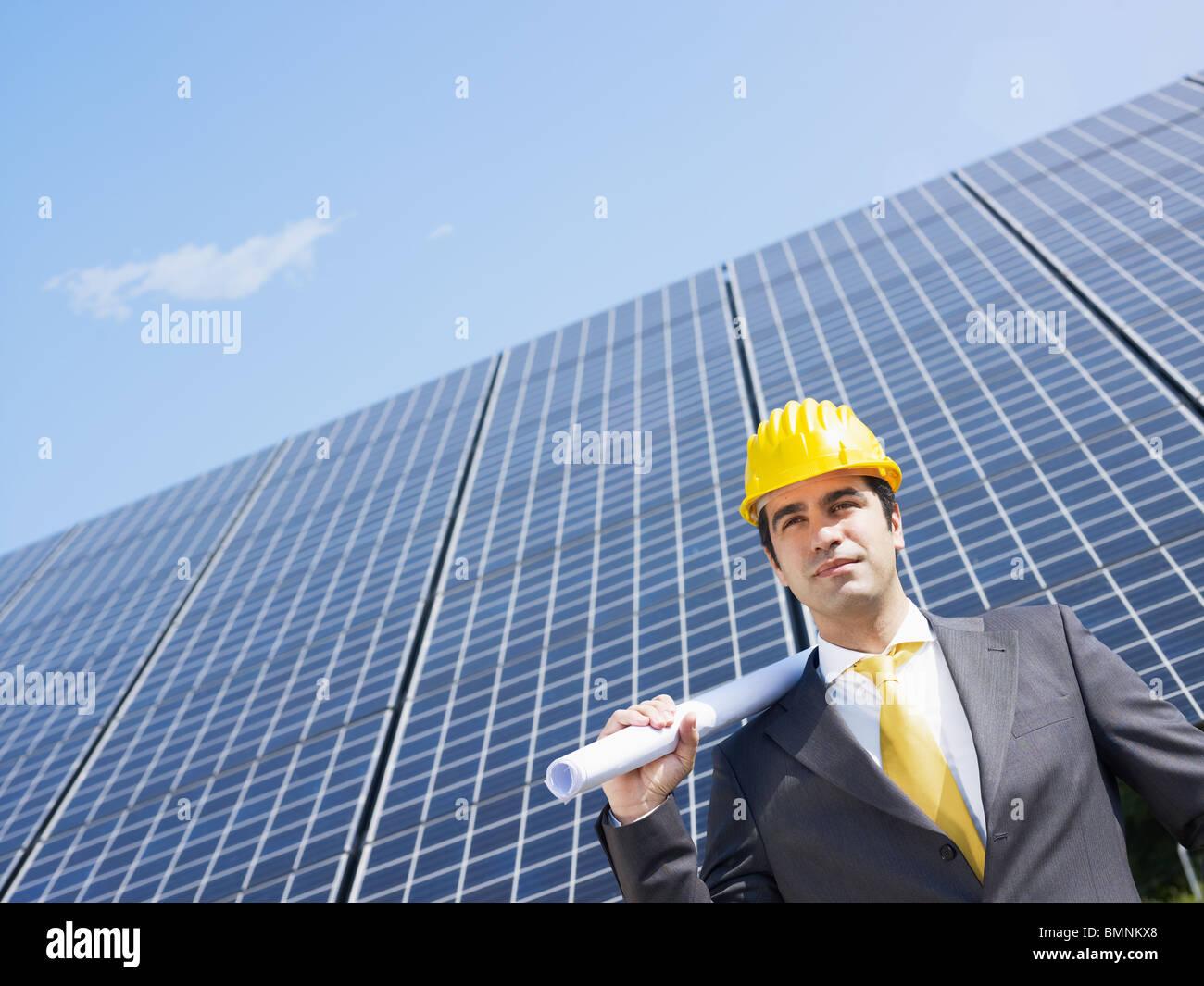 male engineer near solar panels - Stock Image