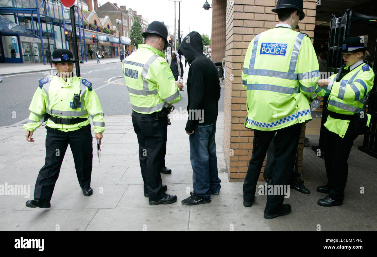 police perform a stop and search in harrow uk - Stock Image