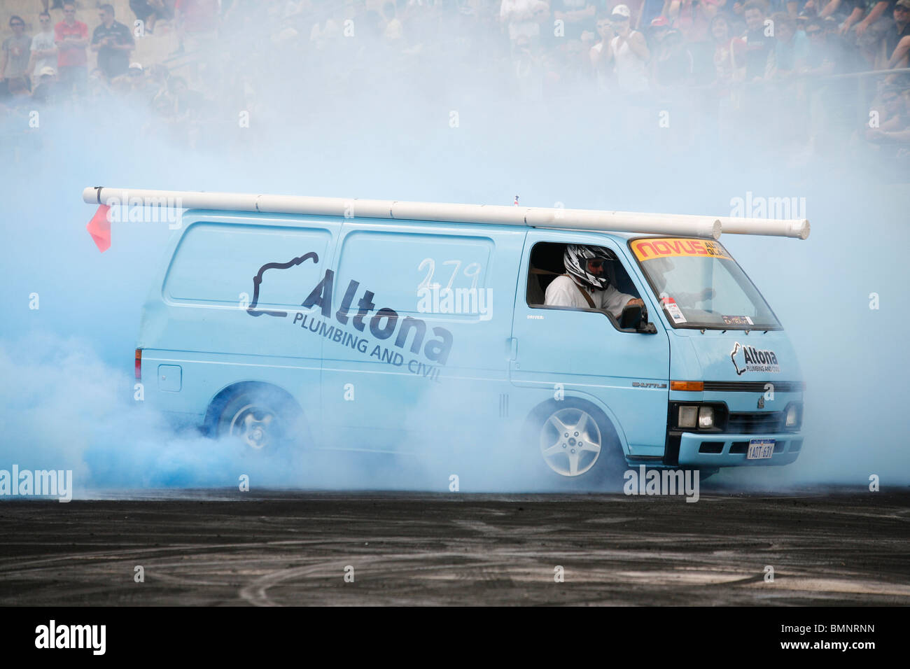 Holden Shuttle work van truck modified to perform massive tire tyre smoking burning rubber burnouts at Australian Stock Photo