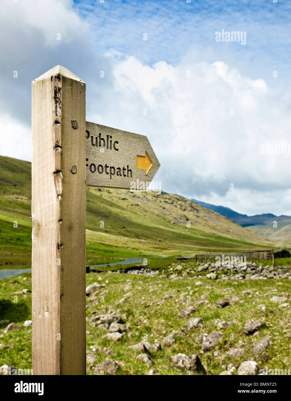 Public footpath wooden signpost in a remote valley in The Lake District England UK - Stock Image
