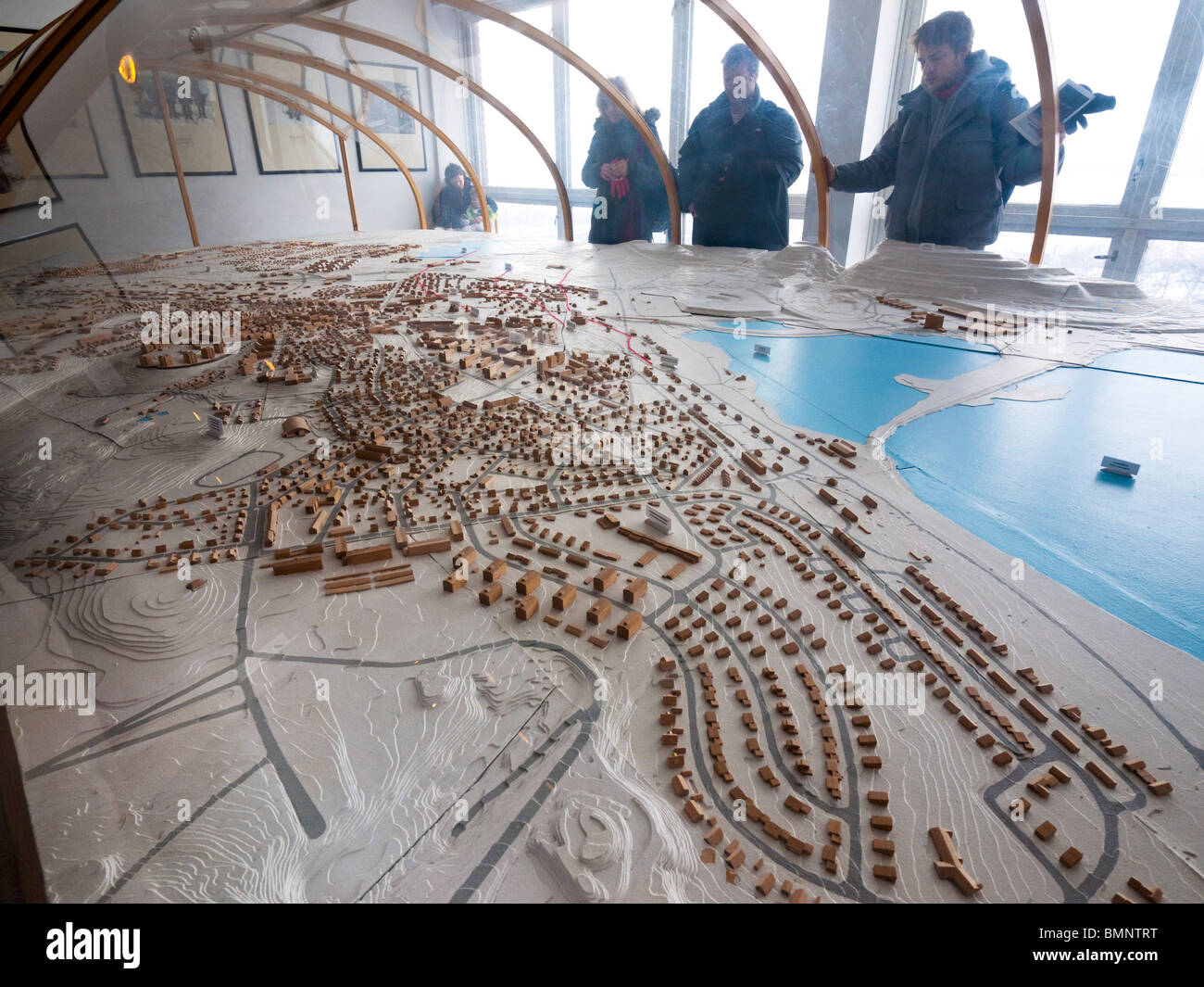 Visitors look at a mockup of the city of Kiruna in the local townhall. - Stock Image