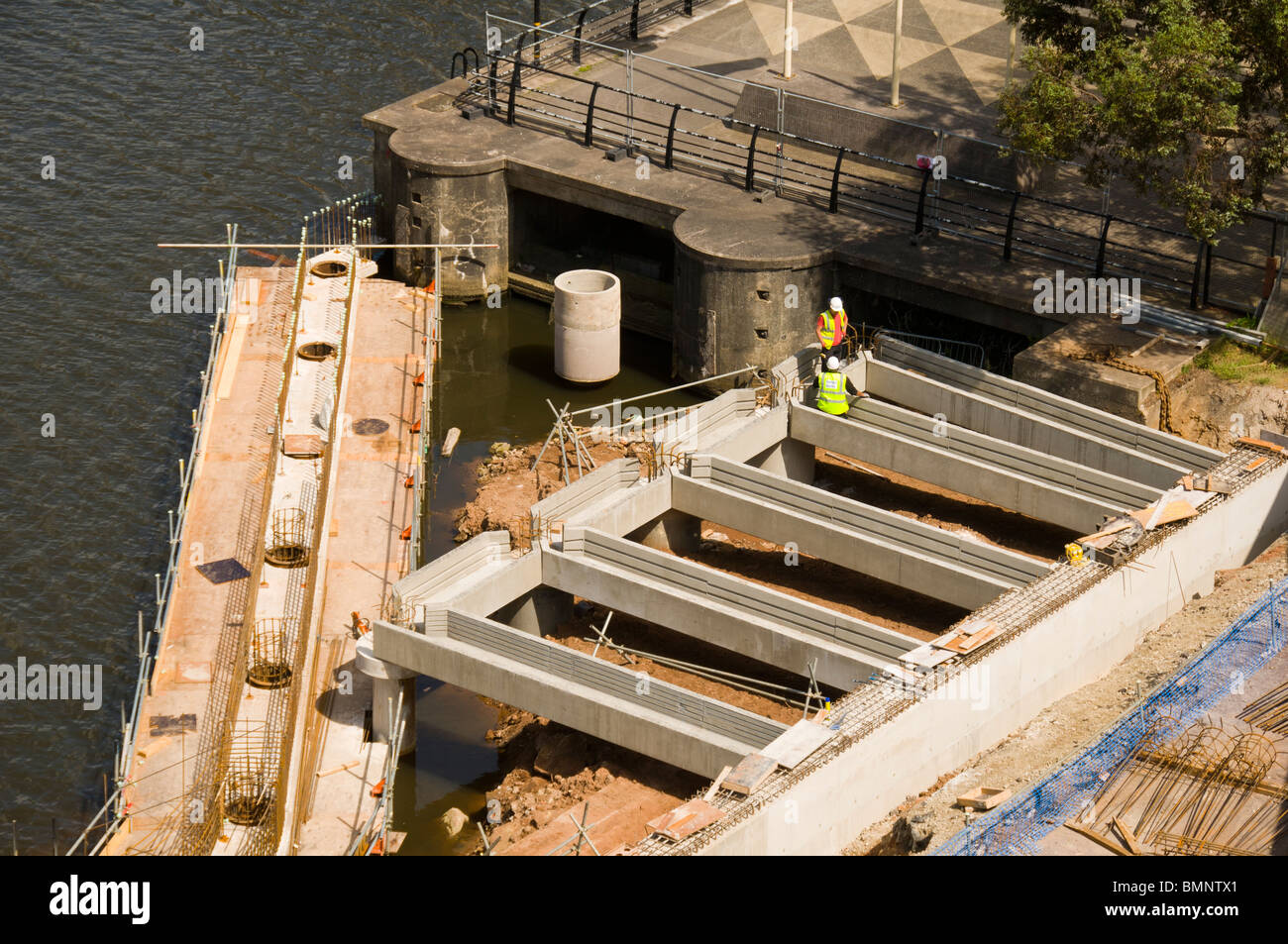 Construction work on a new promenade and walkway outside the Imperial War Museum North at Salford Quays, Manchester, - Stock Image