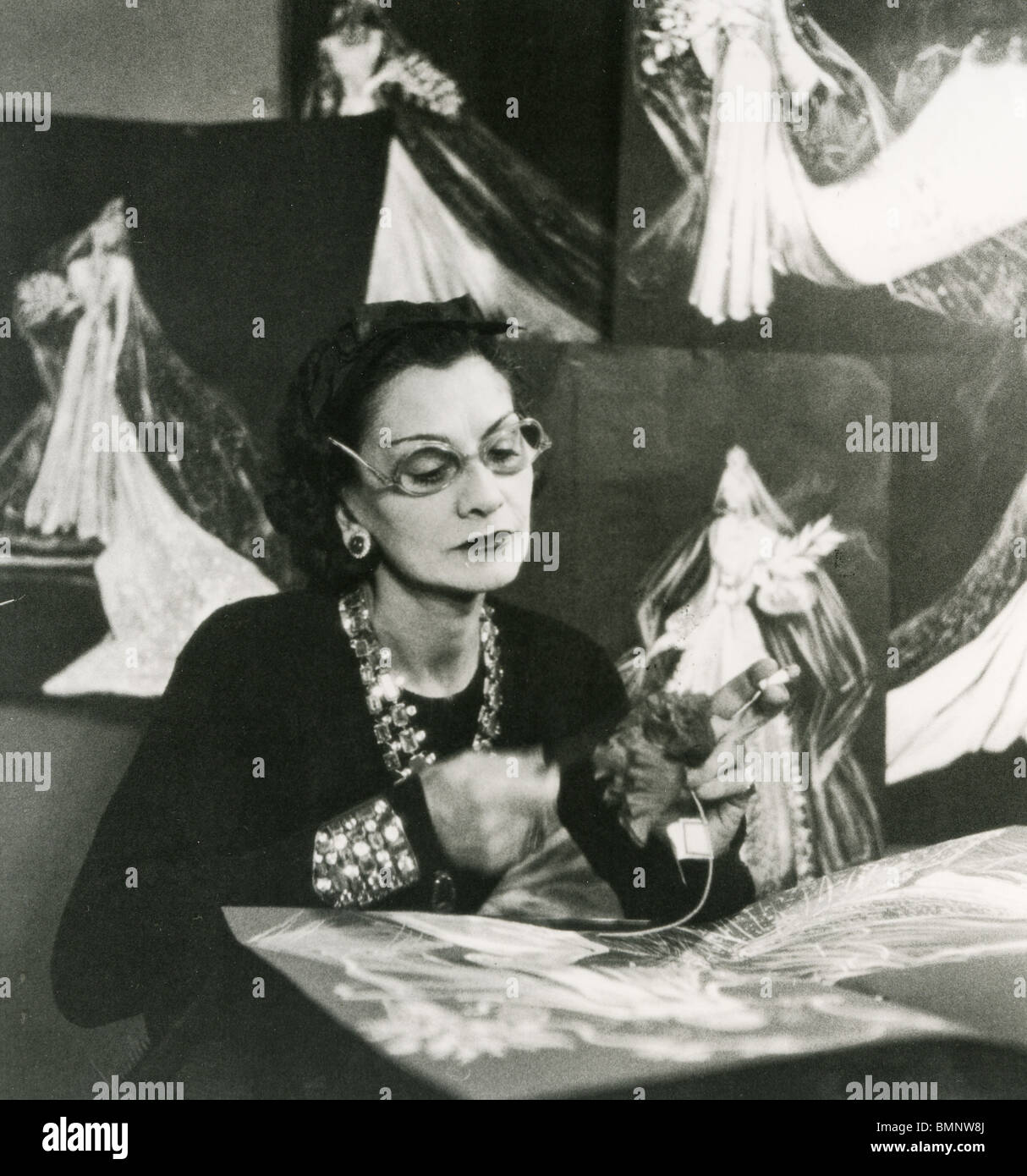 COCO CHANEL , French fashion designer (1883,1971) at work in